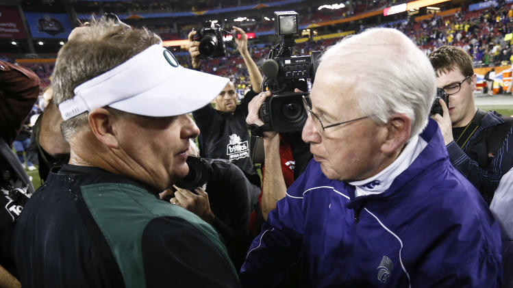 Oregon head coach Chip Kelly, left, and Kansas State head coach Bill Snyder meet on the field after the Fiesta Bowl NCAA college football game Thursday, Jan. 3, 2013, in Glendale, Ariz.  Oregon defeated Kansas State 35-17.(AP Photo/Ross D. Franklin)