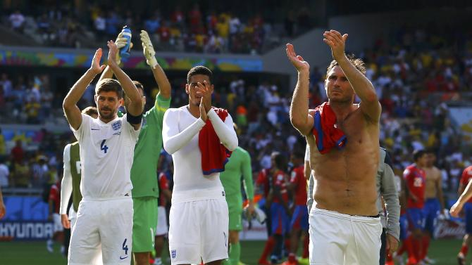 England's Gerrard, Smalling and Lampard acknowledge the crowd at the end of their 2014 World Cup Group D soccer match against Costa Rica at the Mineirao stadium in Belo Horizonte