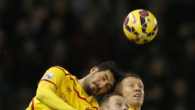 Liverpool's Emre Can and Liverpool's Lucas Leiva challenge Burnley's Scott Arfield during their English Premier League soccer match at Turf Moor in Burnley