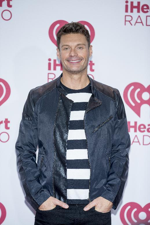Ryan Seacrest arrives at the iHeart Radio Music Festival, Friday Sept. 19, 2014, at The MGM Grand Garden Arena in Las Vegas. (Photo by Andrew Estey/Invision/AP)