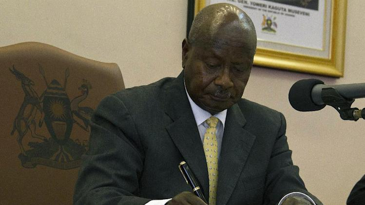 Uganda''s President Yoweri Museveni signs the Anti-Homosexuality Bill on February 24, 2014 in Entebbe