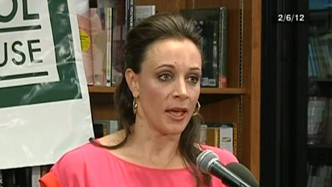 """In the frame grab from C-SPAN Book TV video taken Feb. 6, 2012, author Paula Broadwell speaks to an audience about the book she co-authored, """"All In: The Education of General David Petraeus,"""" at the Politics and Prose bookstore in Washington. The scandal that brought down CIA Director David Petraeus started with harassing emails sent by his biographer and paramour, Broadwell, to another woman, and eventually led the FBI to discover he was having an affair, U.S. officials told The Associated Press on Saturday, Nov. 10, 2012. Petraeus quit Friday, Nov. 9, after acknowledging an extramarital relationship. (AP Photo/C-SPAN Book TV)"""