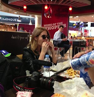 Celebs eating junk food: Made in Chelsea's Millie Mackintosh ditches the diet for a minute to tuck into a massive Burger King meal. Copyright [Instagram]