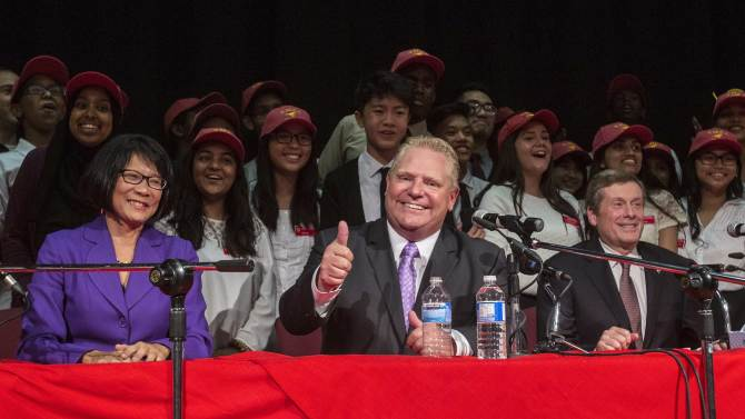 Toronto mayoral candidates Ford, Chow, and John pose with school children after a municipal debate for the upcoming city election in Toronto
