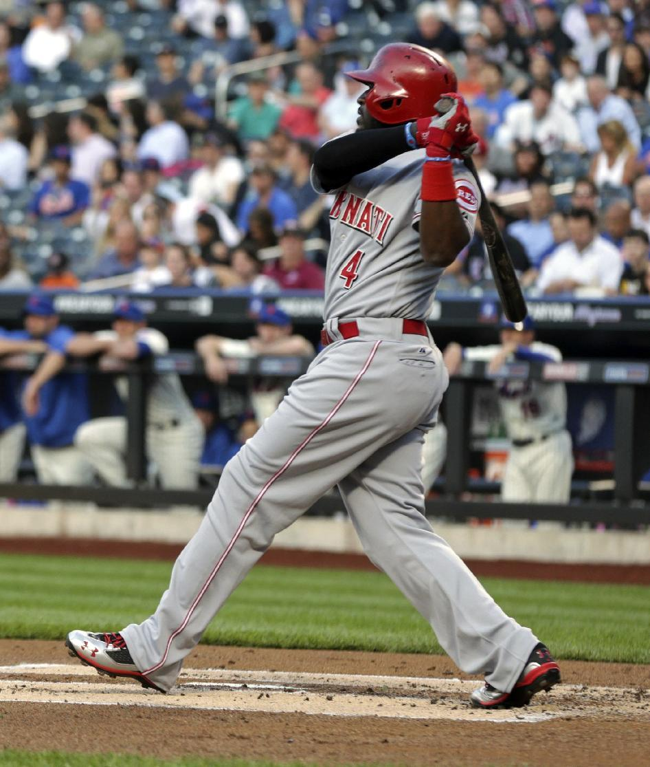 Cincinnati Reds' Brandon Phillips hits a two-run single during the first inning of the baseball game against the New York Mets at Citi Field Monday, May 20, 2013 in New York. (AP Photo/Seth Wenig)