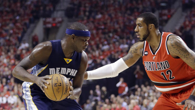 Memphis Grizzlies forward Zach Randolph, left, looks to drive against Portland Trail Blazers forward LaMarcus Aldridge during the first half of Game 3 of a first-round NBA basketball playoff series in Portland, Ore., Saturday, April 25, 2015. (AP Photo/Don Ryan)