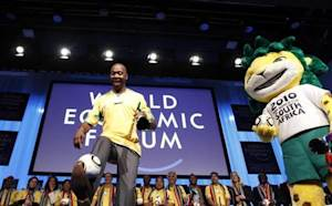 Former South Africa and Leeds United player Radebe kicks ball during 2010 FIFA World Cup South Africa Davos kick-off at the congress centre in Davos