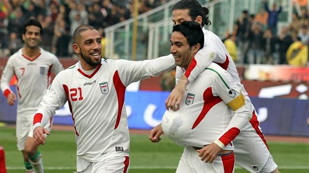 Iran's Javad Nekounam (R) celebrates after scoring a goal against Lebanon during their 2015 AFC Asian Cup group B qualifying football match at the Azadi Stadium in Tehran on February 6, 2013 (AFP)