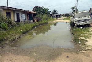 Waterlogged Ibafo Community School road is seen being …