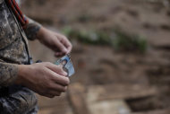A rescue worker holds a photograph of a child where they found several bodies after a landslide in Nova Friburgo, Rio de Janeiro state, Brazil, Saturday, Jan. 15, 2011. After four nights of torrential rains, mudslides have killed more than 500 people in the Rio de Janeiro area.