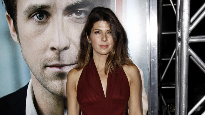 "Cast member Marisa Tomei arrives at the premiere of ""The Ides of March"", in Beverly Hills, Calif., Tuesday, Sept. 27, 2011.  ""The Ides of March"" opens in theaters Oct. 7, 2011. (AP Photo/Matt Sayles)"