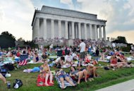 <p>People gather at the Lincoln Memorial to watch fireworks in celebration of Fourth of July in Washington, DC, on July 4, 2012. Independence Day, commonly known as the Fourth of July, is a federal holiday in US commemorating the adoption of the Declaration of Independence on July 4, 1776, declaring independence from Great Britain.</p>