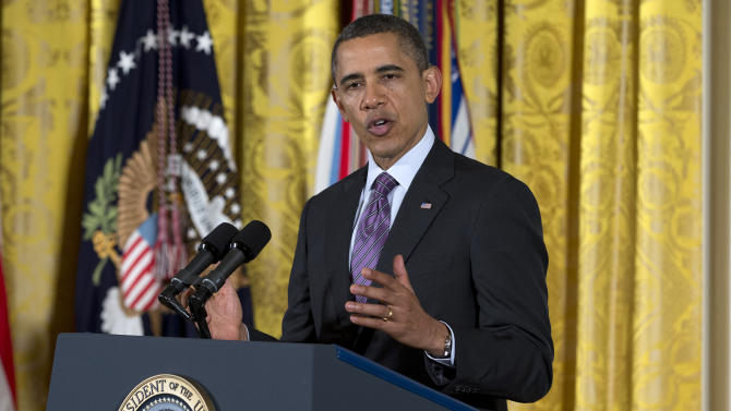 Obama to stress jobs; audience's message is guns