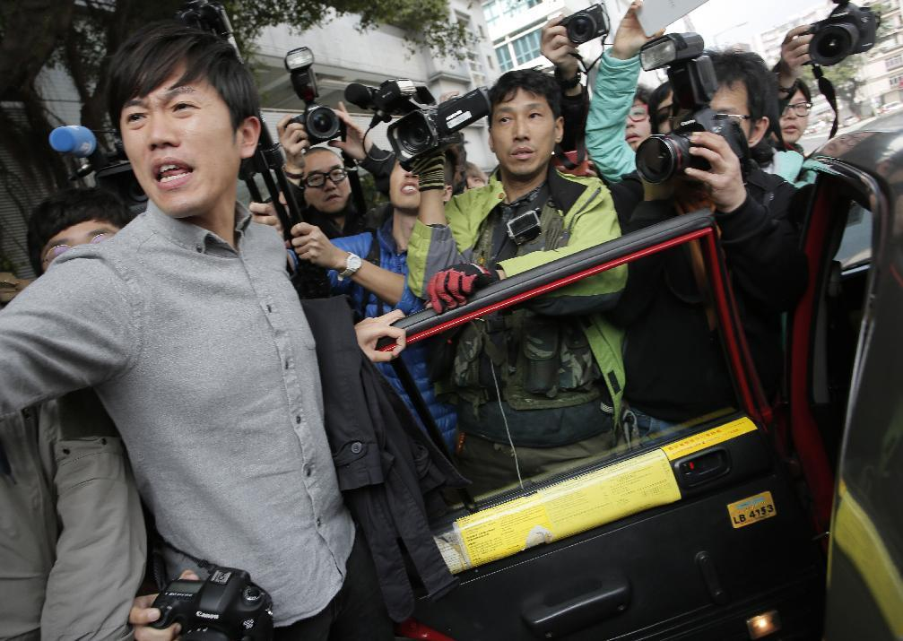 Hong Kong activists face riot charges after holiday protest