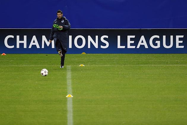 FC Porto's coach Paulo Fonseca kicks the ball during a training session in Madrid, Spain, Tuesday, Dec. 10, 2013. FC Porto will play Atletico Madrid Wednesday in a Group G Champions League soccer