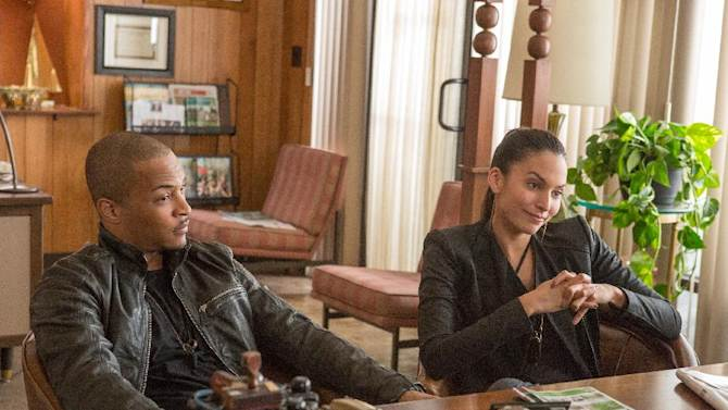 """This undated publicity image released by Universal Pictures shows T.I, left, and Genesis Rodriguez in a scene from, """"Identity Thief."""" (AP Photo/Universal Pictures)"""