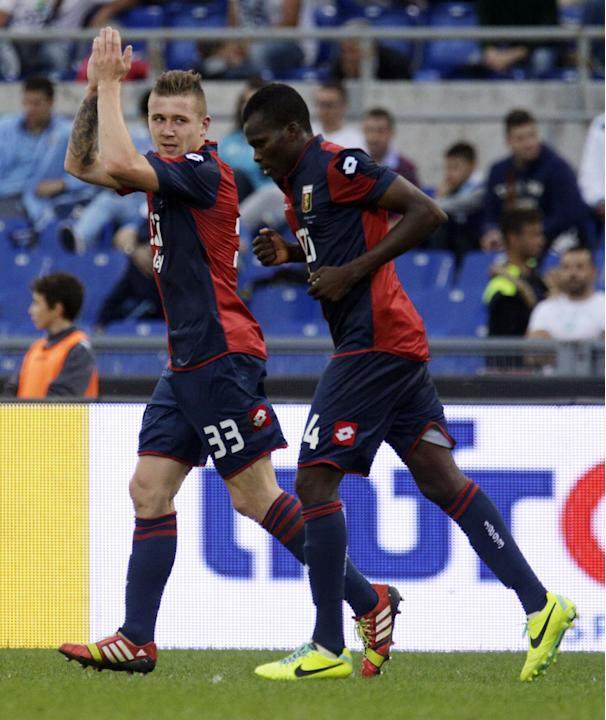 Genoa midfielder Juraj Kucka of Slovakia, left, celebrates with his teammae Genoa midfielder Isaac Cofie of Ghana after he scored during a Serie A soccer match between Lazio and Genoa, at Rome's Olymp