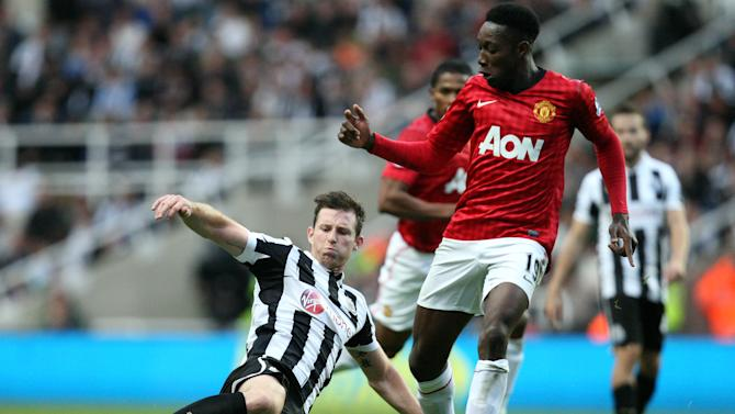 Newcastle United's Mike Williamson, left, vies for the ball with Manchester United's Danny Welbeck, right, during their English Premier League soccer match at the Sports Direct Arena, Newcastle, England, Sunday, Oct. 7, 2012. (AP Photo/Scott Heppell)