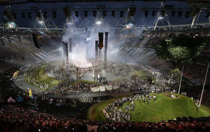Actors perform during an enactment of the Industrial Revolution at the Opening Ceremony at the 2012 Summer Olympics, Friday, July 27, 2012, in London. (AP Photo/Markus Schreiber)