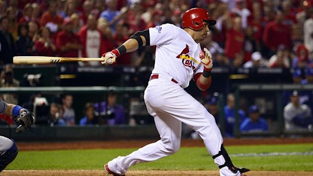 St. Louis Cardinals right fielder Carlos Beltran drives in the winning run in the 13th inning against the Los Angeles Dodgers (Reuters)
