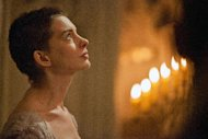 This film image released by Universal Pictures shows actress Anne Hathaway portraying Fantine, a struggling, sickly mother forced into prostitution in 1800s Paris, in a scene from the screen adaptation of &quot;Les Miserables.&quot; Hathaway was nominated Thursday, Dec. 13, 2012 for a Golden Globe for best supporting actress for her role in Les Miserables. The 70th annual Golden Globe Awards will be held on Jan. 13. (AP Photo/Universal Pictures, Laurie Sparham)