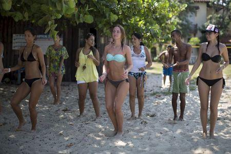 Tourists dance during a salsa class at the beach in Varadero, Cuba
