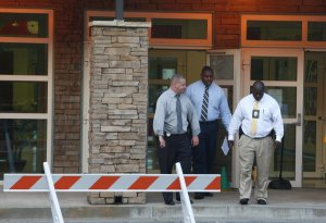 Police investigators are at the front entrance of McNair…