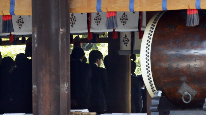 A group of Japanese lawmakers wait in line to prepare to pray the Yasukuni Shrine in Tokyo during an annual spring festival on Tuesday, April 23, 2013. Marking the spring festival, 168 lawmakers paid homage to the controversial war shrine. (AP Photo/Koji Sasahara)