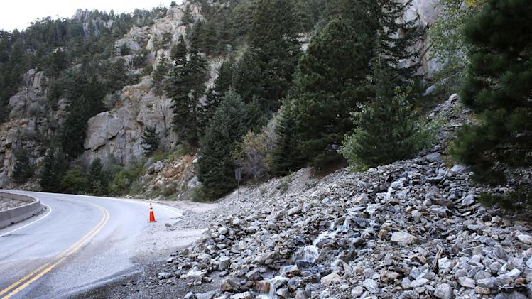 A rock slide partially blocks a closed canyon road, which links Boulder with the mountain town of Nederland, and which is damaged in places by recent flooding, up Boulder Canyon, west of Boulder, Colo., Friday Sept. 20, 2013. With snow already dusting Colorado's highest peaks, the state is scrambling to replace key mountain highways washed away by flooding. More than 200 miles of state highways and at least 50 bridges were damaged or destroyed, not counting many more county roads. (AP Photo/Brennan Linsley)