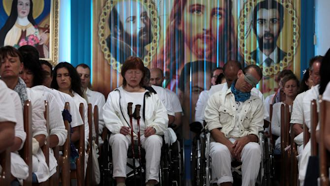 "In this Feb. 23, 2012 photo, patients sit as they prepare to undergo spiritual cures at the ""Casa de Dom Inacio de Loyola"" in Abadiania, in the state of Goias, Brazil. The ""Casa de Dom Inacio de Loyola,"" or ""The House of Saint Inacio de Loyola,"" was founded by popular faith healer Joao Teixeira de Faria in Abadiania, Brazil in 1978, where people seek cures for illnesses. (AP Photo/Eraldo Peres)"