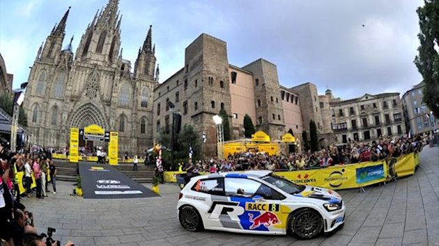 French driver Sebastien Ogier takes the starts of the 49th Rally of Catalunya in front of the Cathedral of Barcelona (AFP)