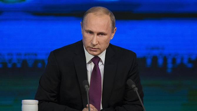 Russian President Vladimir Putin speaks during his annual news conference in Moscow, Russia, Thursday, Dec. 18, 2014. Putin says Russia has sufficient currency reserves and the ruble will recover. (AP Photo/Pavel Golovkin)