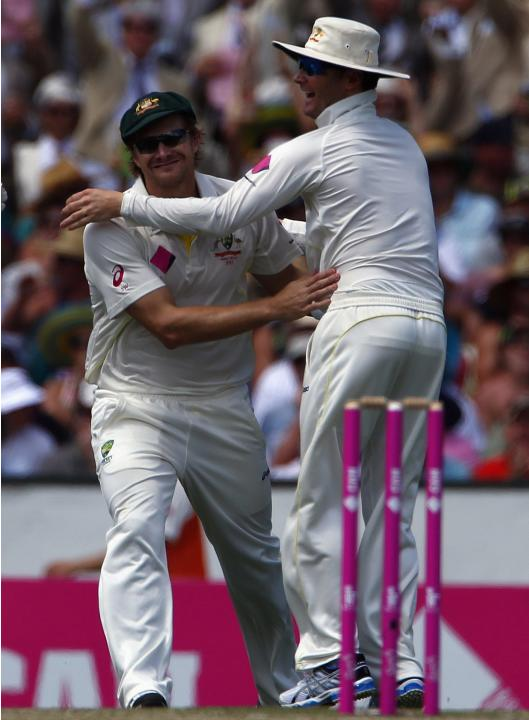 Australia's Watson celebrates with captain Clarke after he caught out England's Pietersen during the second day of the fifth Ashes cricket test at the Sydney cricket ground