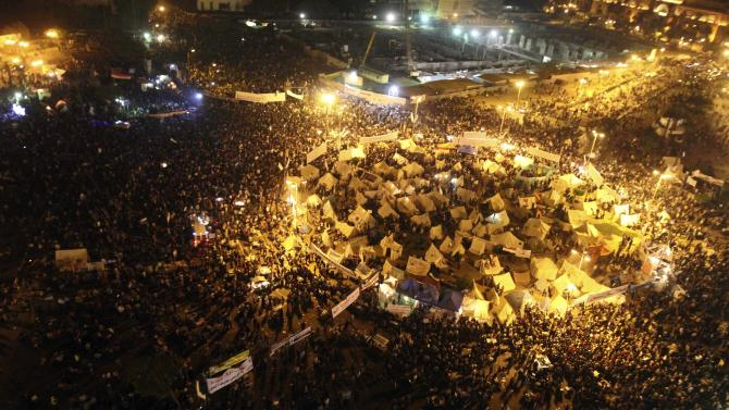 Protesters gather in Tahrir Square in Cairo, Egypt, Friday, Nov. 30, 2012. Giant crowds of protesters packed Cairo's Tahrir Square and marched in other cities Friday vowing to stop a draft constitution that Islamist allies of President Mohammed Morsi approved hours earlier in a rushed, all-night session without the participation of liberals and Christians. (AP Photo/Ahmed Ramadan)