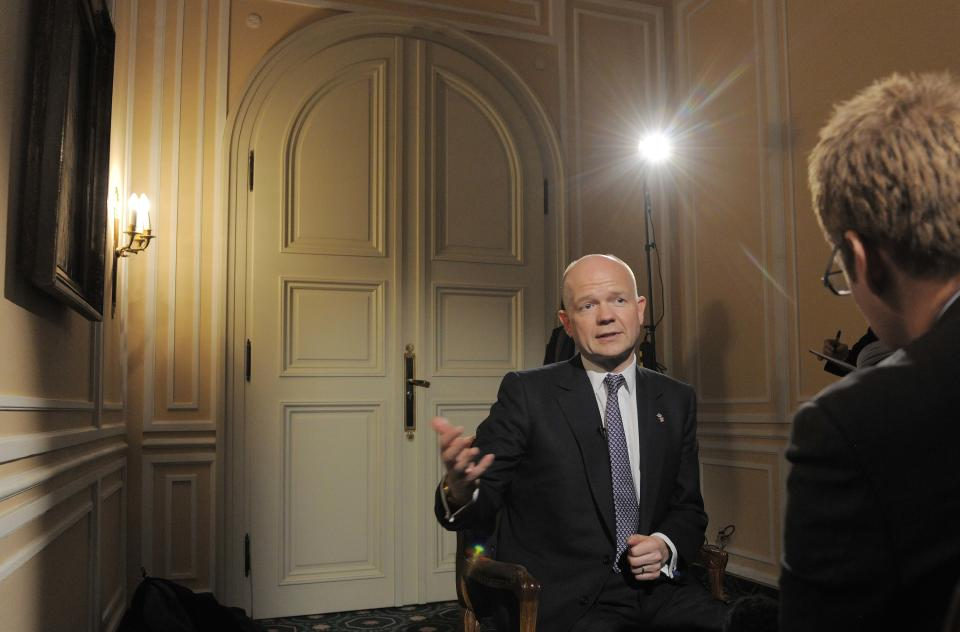 Britain's Foreign Minister William Hague gestures during an interview with The Associated Press and BBC at the International Conference on Security Policy at the hotel 'Bayerischer Hof' in Munich, southern Germany, Friday, Feb. 4, 2011. (AP Photo/Jens Meyer)