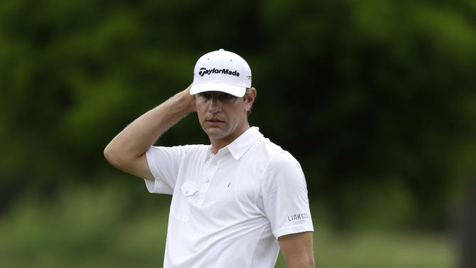 Lucas Glover reacts to a putt on the second green during the final round of the PGA Zurich Classic golf tournament at TPC Louisiana in Avondale, La., Sunday, April 28, 2013. (AP Photo/Gerald Herbert)