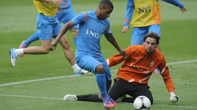 Luciano Narsingh and Tim Krul (R) attend a training session during Euro 2012 at Wisla stadium in Krakow (Reuters)