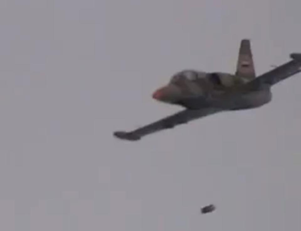 In this image taken from video obtained Friday, Sept. 21, 2012 from the Ugarit News, which has been authenticated based on its contents and other AP reporting, shows a government warplane dropping a bomb on Aleppo, Syria, Wednesday, Sept 19, 2012. (AP Photo/Ugarit News via AP video)