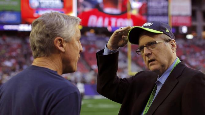 Seattle Seahawks head coach Carroll talks with team owner Allen ahead of the NFL Super Bowl XLIX football game against the New England Patriots in Glendale