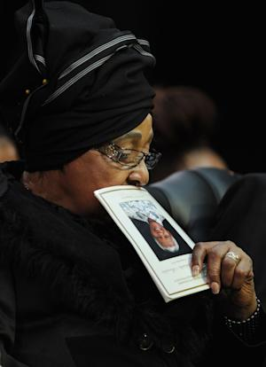 Winnie Madikizela-Mandela, Nelson Mandela's former wife, holds up the service program while attending former South African President Nelson Mandela's funeral service in Qunu, South Africa, Sunday, Dec. 15, 2013. (AP Photo/Odd Andersen, Pool)