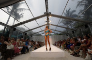 A model wears swimwear from the Aqua di Lara collection of during the Mercedes-Benz Fashion Week Swim 2013 show, Saturday, July 21, 2012, in Miami Beach, Fla. (AP Photo/Lynne Sladky)