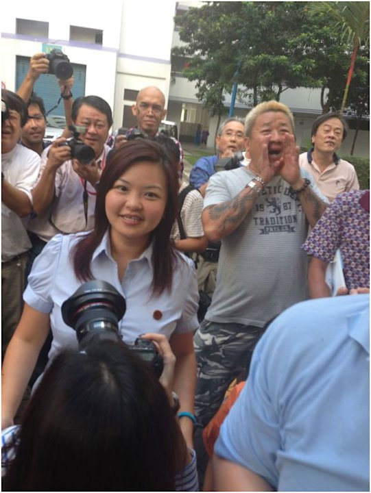 Punggol East by-election winner Lee Li Lian arrives for Workers' Party's parade. Supporters are all smiles.