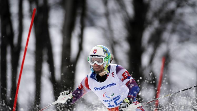 Slovakia's Dudas is led by his guide Cerven during the Men's Visually Impaired Slalom event at the 2014 Sochi Paralympic Winter Games at the Rosa Khutor Alpine Center