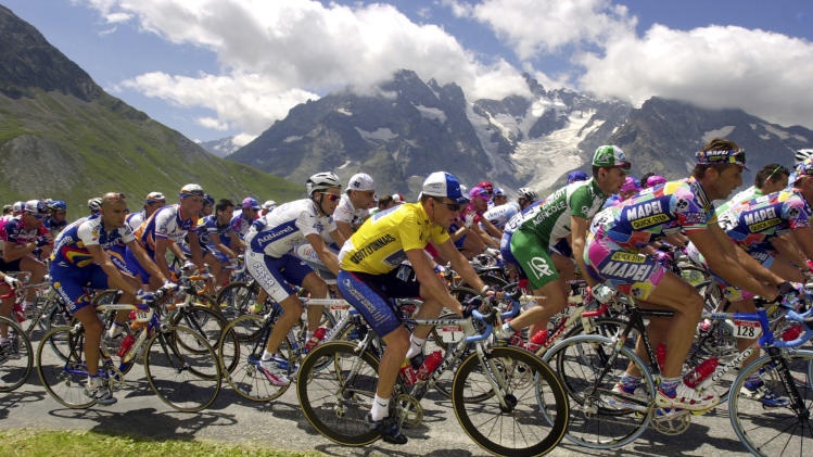 FILE - In this July 24, 2002, file photo, the pack, with overall leader Lance Armstrong, center, ascends the Col du Galibier pass during the 16th stage of the Tour de France cycling race between Les Deux Alpes and La Plagne, French Alps. After a decade of denial and being stripped of his titles, Armstrong has finally come clean_ During an interview with Oprah Winfrey taped Monday, Jan. 14, 2013, Armstrong said he used performance-enhancing drugs to win the Tour de France, a person familiar with the situation told The Associated Press. (AP Photo/Peter Dejong, File)