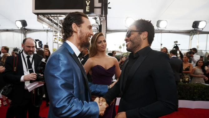 Matthew McConaughey and Camila Alves speak with Lenny Kravitz at the 21st annual Screen Actors Guild Awards in Los Angeles