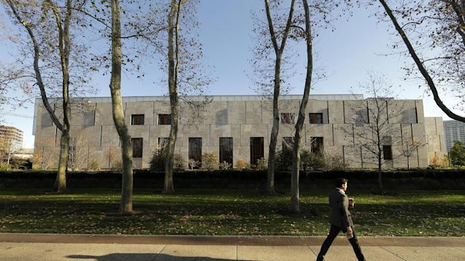 A man walks in front of The Barnes Foundation Tuesday, Nov. 24, 2015, in Philadelphia. The museum and its renowned collection of Renoirs, Matisses, Picassos, and Cézannes has drawn huge crowds since moving from a small suburban location with limited access and hours to Philadelphia's museum row. Now it is looking to reach out even further to the broader community with expanded programming, bolstered by a major fundraising drive. (AP Photo/Matt Rourke)