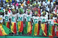 Senegalese supporters watch a football match in June 2012. Egypt, Gabon, Morocco and Senegal can draw strength from African football achievements at recent Olympics when they set off this month in search of medals