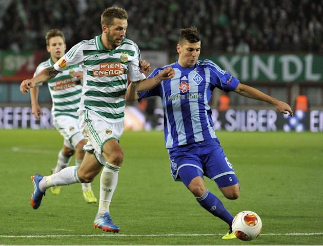 Rapid's Guido Burgstaller, left, and Kiev's Aleksandar Dragovic challenge for the ball, during their Europa League second round group G soccer match between SK Rapid Wien and FC Dynamo Kiev, in Vienna