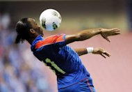 Former Chelsea star Didier Drogba of Shanghai Shenhua fields the ball before his team beat Liaoning Whowin 3-0 in the Chinese Super League match in Shanghai on September 15. FIFA have turned down a request from Ivorian striker Drogba to be allowed to leave Chinese club Shanghai Shenhua on loan to a European club ahead of the transfer window.