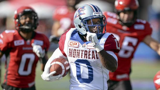 Montreal Alouettes' Logan outruns the Calgary Stampeders' defence for a touchdown during a CFL football game in Calgary